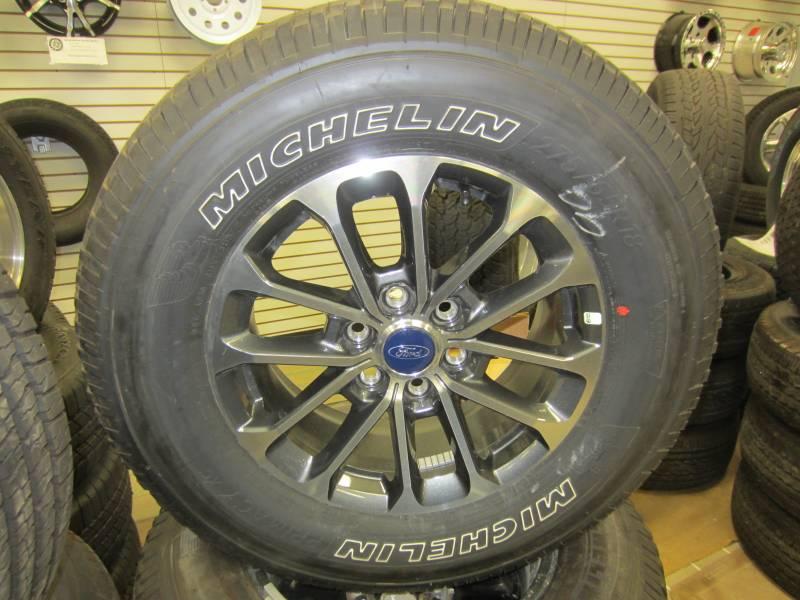 ford    lug  polished aluminum wheel michelin primacy xc  tires