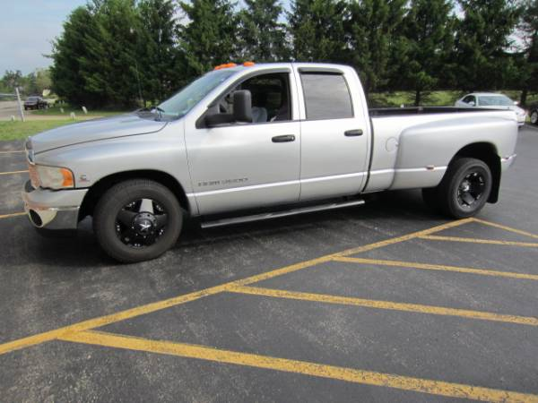 "Ford Explorer Black Rims >> Photo Gallery - 09-16 Dodge Ram - Dodge RAM 3500 Dually with 17"" Black Rockstar Dually Wheels"