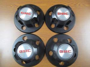 85-94 GMC Safari Van 15 in. Steel Wheel Black OEM Center Caps (Set of 4)
