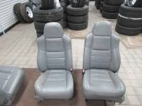New and Used OEM Seats - Ford Replacement Seats - 05-06-07 Ford F-250/F-350 Gray Leather Lariat 40/20/40 Bucket Both Power seats w/ manual recline & Lumbar w/o center jump